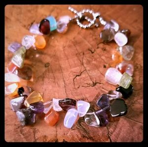 Women's variety of gems bracelet with toggle clasp